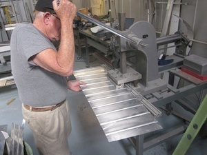 An arbor press  set up to make the a small bend required in the fabrication of a Cessna lower aileron skin